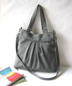 Love this shade of grey, the style and versatility of the bag... well, just everything! Must buy! Comes in other colors too!