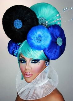 "Kenya Michaels, RuPaul's Drag Race, wearing a wig or ""borrowed hair"" (Schiaparelli 32)."