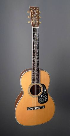 Martin 00-45 in Brazilian Rosewood and Adirondack (Red) Spruce, with Tree of Life inlay on the fingerboard, pick guard, and bridge.