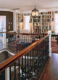 "I love the little semi-oval space the rail creates, bookcases, lighting, seating, rug and wood floor. A little library has been created out of ""dead"" space. This is just too good for words (Southern Living Idea House, Charleston)."