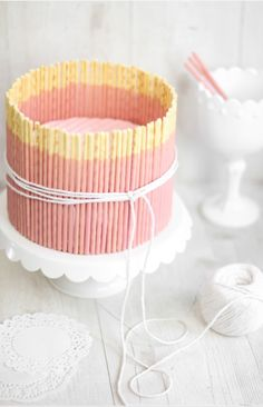 Pink Vanilla Pocky Cake / 6-inch personal-size cake with flecks of vanilla bean throughout, and possibly surrounded with strawberry pocky. www.sprinklebakes.com