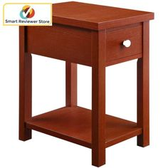 Square End Table with Drawer Oxford Wood Desk Furniture Red By Whalen Furniture This Blue end table offers versatile storage as an accent table for the living areas of your home. It is an ideal solution for your lamp, plant or books and magazines. It features a concealed storage drawer and a lower open shelf space. Antique bronze hardware complements the red finish. Better Homes and Gardens Oxford Square End Table with Drawer, Red Home Furniture Living Room Furniture Accent TablesThis Blue…
