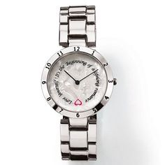 """Silvertone bracelet watch that has a rotating disc with an inspirational message that functions as a second hand. Message says """"Love Yourself! It's the Beginning of a lifetime romance"""". There is a pink heart at the beginning of the quote.· Band: 6 1/2"""" L x 3/4"""" W with Foldover clasp· Extender: 1 1/2"""" L· Battery: Replaceable SR626SW· Movement: Quartz· Imported Paula Abdul is an award-winning, singer-songwriter, dancer, choreographer and television personality."""