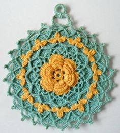 """Watch Maggie review this pretty Vintage Blue & Yellow Potholder Crochet Patterns! Design by: Maggie Weldon Skill Level: Intermediate Sizes:Shells in the Round - About 7"""" diameter Yellow & White Dress                                                                                                                                                                                  More"""