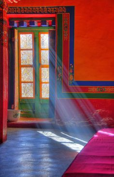What beautiful colors!  Great shot with the light streaming through the door like that.  Ahhh!