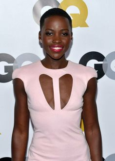A pink pout and Dana Rebecca Designs, pink geometric studs and ring completed Lupita's look.  Lupita was spotted at the GQ Men of the Year Party wearing a CUSHNIE ET OCHS pre-Fall 2013 Pink Cutout Jersey Dress, Devi Kroell, pink/silver clutch and Christian Louboutin white strappy heels.  Photo credit: The Fashion Bomb — at Royal Opera House.