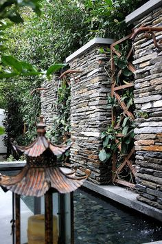 Lantern and stacked stone fountain walls