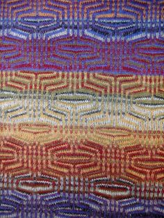 The Caravan Rhapsody scarf from Karen Allen has an amazing mix of colors in blues, purple, red, green, yellow. 100% cashmere, the finest in the world, from Scotland and Italy. Medium $325, 8″ wide X 60″ /Long $375, 10″ wide X 72″ long. Please call the store for availability.