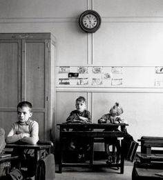 "my-retro-vintage:  "" The School Clock Paris © Robert Doisneau 1956  """