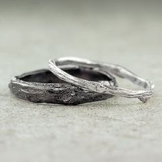 This listing is for two rustic branch wedding bands.  These rings are cast from an actual tree branches. The natural form of the branch is intact so you can easily see the node and characteristics of the branch. Measurements: The wider band measures 3.8 up to 5mm in width and the narrower band measures 1.7-2.4mm in width. These rings are made of eco friendly recycled metal. The sterling silver is from 100% recycled sources.  Finish Types: The wider ring is shown with an oxidized finish and…