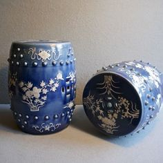 A pair of pretty Chinese Export porcelain garden barrel seats, mid 20th century, with floral sprays and pierced decoration against a blue glaze, 32cm (12 ½ inches) high, 23cm (9 inches) wide.