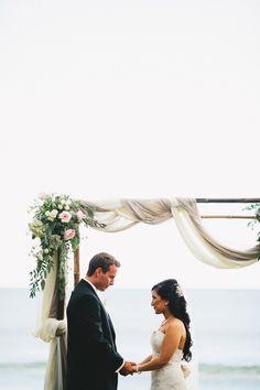 Fabric arbor  simple elegance Photography: Braun Photography - braun-photography.com  Read More: http://www.stylemepretty.com/2014/06/20/romantic-outdoor-wedding-on-the-shores-of-maui/