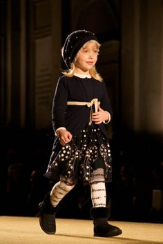 Only one word for this, WOW. the entire outfit just works. This little girl has been on the runway before and it shows. Talented model and child designer.