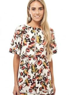 White floral print playsuit with open back www.UsTrendy.com