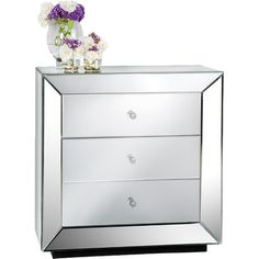 Top this shimmering 3-drawer nightstand with a colorful lamp and bedside tray, or let a pair flank either side of your bed for a dramatic look. ...