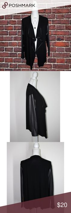 """Black Bebo Jacket This jacket can create so many looks. It would look fab with black sheen pants!  * Stretchy * Arms and trim have a shiny leather look * Longer sides in front * Lightweight  * 95% viscose/5% elastane   MEASUREMENTS (Approximate)  * Armpit to pit 19"""" * Waist 39"""" * Hips 41"""" * Length back 25.5"""" * Length sides 30""""  This jacket by Bebo is in stellar condition and is without flaws. It is a size Medium/Large. (I believe it runs rather big). Bebo Jackets & Coats"""