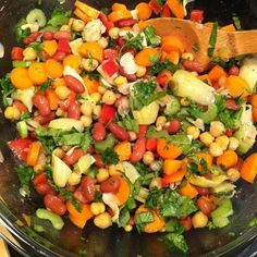 Heart healthy salad. Recipe by our nutritionist at work #DiscoveryCommunications.#redbeans #garbanzos #carrots #celery #redpeppers #artichokes #parsley #basil #limejuice #oliveoil #redwinevinegar #pepper #salt