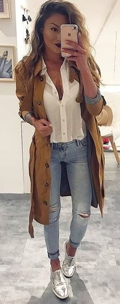 #spring #outfits woman in white button-up collared shirt and brown coat taking selfie. Pic by @streetstyles_world