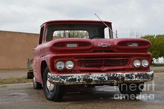 Red Chevy Truck. Classic pickup. Old pickups.