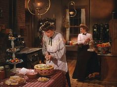 """""""Meet Me in St. Louis"""" movie house.  I read that pots and pans were usually stored on open shelves because they were greasy. Closed cabinets would attract mice and other critters.  Pinned from Hooked on Houses, 12-25-2015."""