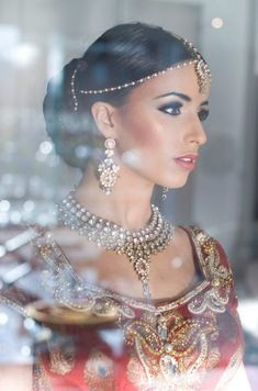 Breathtakingly Beautiful. Love the simple Headpiece (matha patti with maang tikaa) via Beautiful Indian Brides  Makeup by: Shafika Sodawala