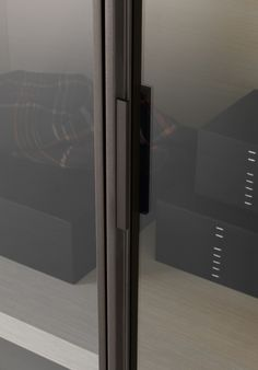 Wardrobes throughout + Smoked mirror details Poliform, wardrobe - Ego - designed by Giuseppe Bavuso (2010).