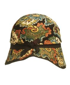 The close fitting cloche, or bell, became the most fashionable shape for womens hats during the 1920s. It perfectly matched short hair and tubular dresses. This example with exotic embroidery was sold by Dickens & Jones in Oxford Street, but made in Paris. It is made of brown wool felt covered in braided embroidery work.  Circa 1925-1930.