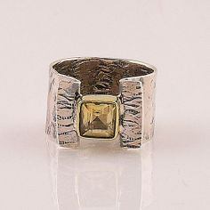 """Genuine Citrine artisan crafted Solid Sterling Silver Size 9 Ring  DETAILS: * Genuine Citrine Ring * Size 9 * 6.3 g total weight * Set in SOLID .925 Sterling Silver * Band Measures approximately 1/2"""" wide  An awesome Two tone artisan crafted Sterling Silver ring that boasts a faceted pr..."""