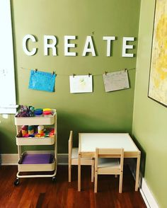 Toddler art corner. Ikea Raskog cart and Latt table and chairs, some twine and mini clothespins, and lots of art supplies for creative expression.