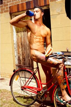 nsfw, my internet babies.  I had to save this, there are SO MANY images of sexualized women on bikes, it's a real rarity to find a hot dude.