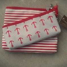 Anchor me makeup bags Brand new with tags set of two makeup bags from francesca's.  A larger red and white striped and small one with anchors all over. Francesca's Collections Bags Cosmetic Bags & Cases