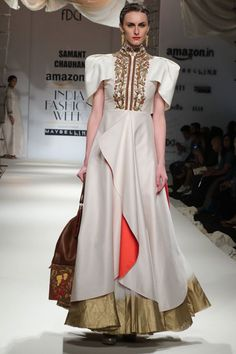 Kinnaur Queen relives through #SamantChauhan's brilliance in capturing the very essence of Indo-Greek regal cultural influences. Garments beautifully draped with golden beads and zarzodi work with contrast red piping mixed eloquently with mute thread work. Embellished with metal trims and leather belt with contrast stitch, colours like cherry and creme white radiated awe. #AIFWSS16 Fashion Design Council of India's photo.