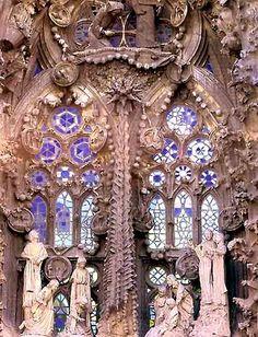 General view of the stained glass of the Nativity's door, La Sagrada Familia, Barcelona, Spain.  architect:  Antoni Gaudi