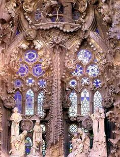 General view of the stained glass of the Nativity's door, La Sagrada Familia, Barcelona, Spain.  architect:  Antoni Gaudi