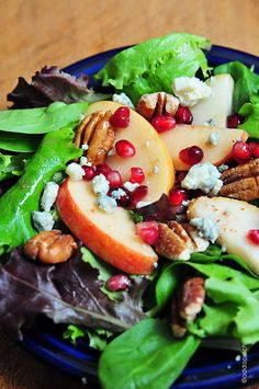 This Apple Pear Salad with Pomegranate Vinaigrette makes a delicious salad anytime of year, but especially throughout the holidays. // addapinch.com