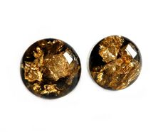 Handmade statement jewellery, designed and made by me.  A staple for any jewelry collection. These stunning Black and Gold resin earrings are perfect for everyday wear and can be dressed up or down. They are elegant and catch the light beautifully when you move. They have been carefully set into 10mm sterling silver bezels with a sterling post and earring back.  I take inspiration from the beautiful designs found in nature and the things around me, to create captivating and one of a kind…