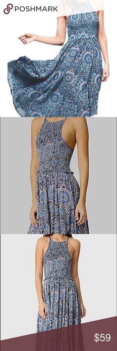 """[Free People] Season in the Sun Dress This elegant dress from Free People features a smocked bodice and an asymmetrical hem. It also features a halter neckline and a razorback-cut back.  A smocked bodice lends a formfitting touch to this swingy Free People floral dress. Sleeveless. Unlined. Fabric: Gauze. 100% rayon. Approx length: 44"""" Free People Dresses Midi"""