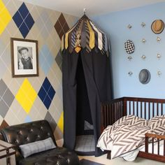 A toddler room that will grow with the boy, featuring menswear inspired patterns and repurposed belts and ties.