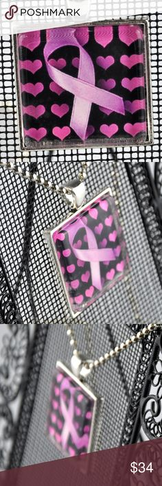 """Pink Hearts Breast Cancer Awareness Necklace Perfect to show your support for those still in the fight, the survivors, or those we have lost. Handmade Pendant is 1"""" square and features a two pink ribbons on a black background. Image is sealed under glass and set in an antique silver tone tray.   Choice of 16"""", 18"""", 20"""" or 24"""" ball chain necklace. See size guide.   Hand assembled so small air bubbles may be present. Water resistant but not waterproof. Photo taken with quarter for size   Smoke…"""