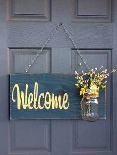 "Rustic Outdoor Spring Welcome Sign  - Size is approximately 12 X 18 inches.  Depth is approximately 5"" with the Mason jar. - Comes ready to hang - Light sealer applied - New wood used -Flowers NOT included - Custom font color (you pick)  FONT COLORS: Tan, White, Yellow, Barn Red, Dark Red (Maroon), or a light green."