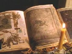 Practical Magic Spellbook. Hallows eve. W/ candles surroundinh
