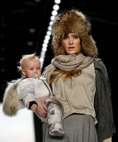 A model with a baby presents a creation by Sportalm at the Berlin Fashion Week Autumn/Winter 2016 in Berlin, Germany, January 19, 2016. (Photo by Fabrizio Bensch/Reuters)