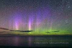 aurora borealis northern lights in the upper peninsula of michigan-subtle multi colored light pillars over Lake Superior, Marquette MI. Publ...