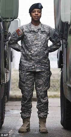 Major Sequana Robinson models a new women's combat uniform that is now being rolled out to all Army bases in the U.S,  2013
