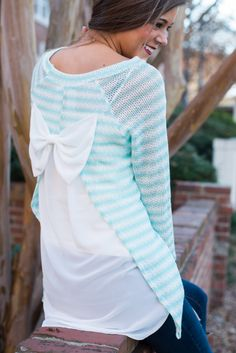 """OMG! How AHHHdorable is this bow-backed cutie! The stripes, the MINT, the peek-a-boo back!? It's all so cute!! <br /> <br />Material has fair amount of stretch. Open sheer back with bow at the top. You might want a cami handy with this one! :) <br />Miranda is wearing the small. <br /> <br />Sizes fit: <br />Small- 0-4; Medium- 6; Large- 8-10 <br />Length from shoulder to hem: S- 30.5""""; M- 31.5""""; L- 32.5""""."""