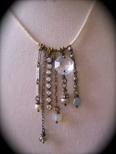 Dangly earrings made into a necklace.