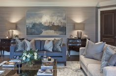Paintings (ideally oil paintings) are the perfect artwork to style a living room with. Either pick out colors from a painting you love and build the color scheme around that, or commission a painting by an artist and send them samples of all the various finishes used in the room. Art really finishes off a room and makes the space come alive.