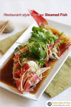 Steamed Fish - fish steamed with soy sauce and topped with shredded ginger, scallions, and cilantro leaves. #seafood #fish