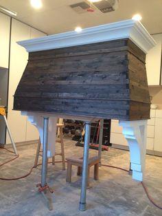 Wood range hood. Reclaimed wood