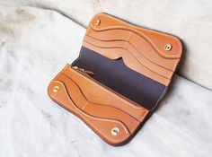 Dreadnought Long Wallet made with tan French calf leather by Steelhead Fine Goods.  This wallet has a ton of storage space with two large bill slots, six card slots, and a large zipper pocket.  Snaps closed.  #frenchcalf #handmade #longwallet